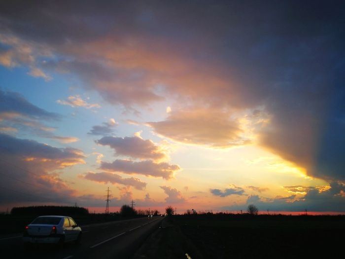 Sunset Road Road Trip Land Vehicle Road Sign Car City Dramatic Sky Driving Highway