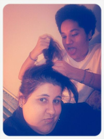 The bestie doing a crappy ass job with my hair lol