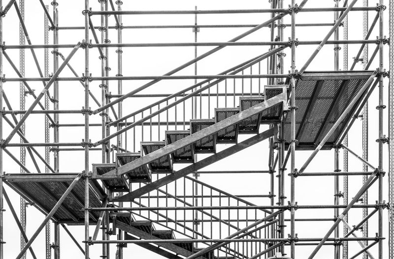 Scaffolding Architecture Built Structure Low Angle View Metal Day No People Railing Sky Staircase Building Exterior Outdoors Nature Steps And Staircases Connection Construction Industry Industry Fire Escape Fuel And Power Generation Construction Site Building Scaffold Scaffolding Netting Ladders Walkways Pattern Geometric