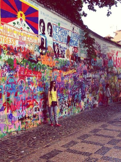 Graffiti Full Length Multi Colored Only Women Street Art One Person Adults Only Architecture Real People Adult One Woman Only Built Structure Standing Day Outdoors People Women Lifestyles EyeEmNewHere Lennonwall Prague