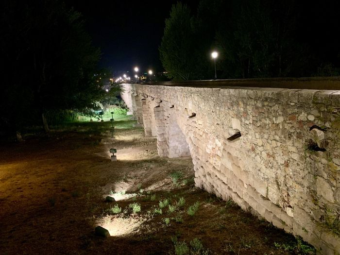 Stone wall in park at night
