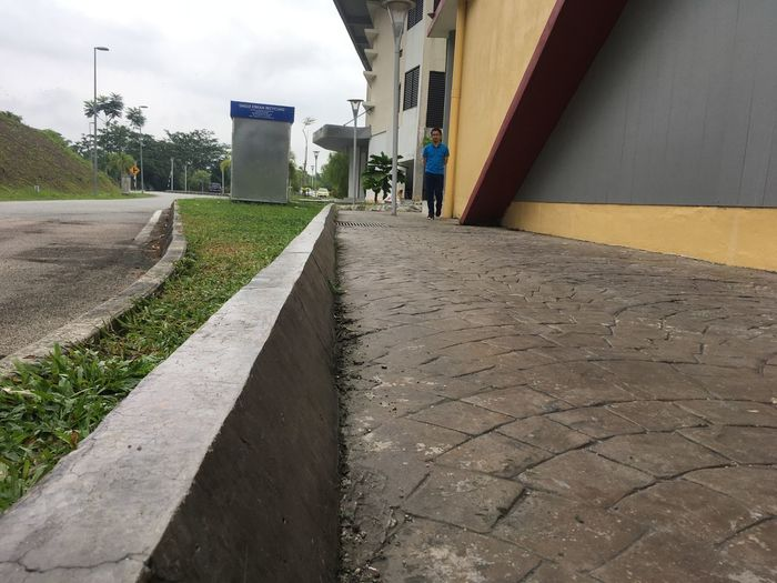 Surface level of footpath amidst buildings in city