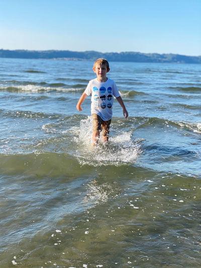 Full length of boy enjoying in sea