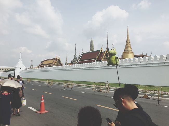 Religion Real People Men Sky Place Of Worship Spirituality Built Structure Cloud - Sky Architecture Rear View Day Women Travel Destinations Lifestyles Building Exterior Outdoors Adult People Bangkok Thailand. WatPhraKaew Palace Wall Walking