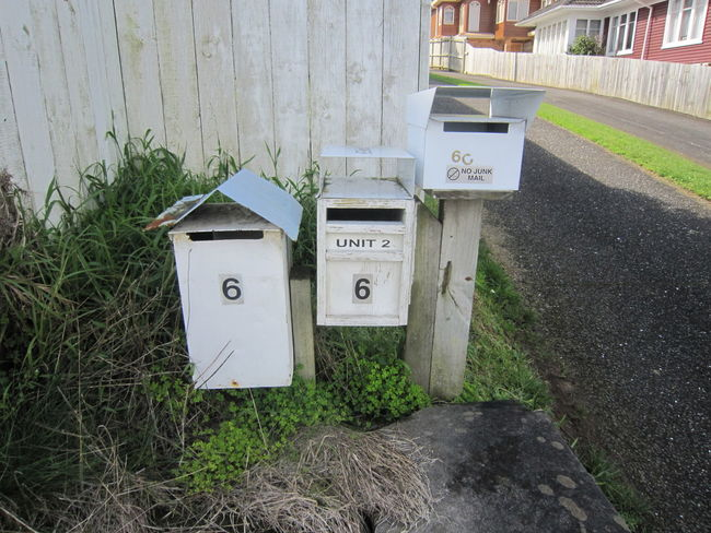 EyeEm Best Shots Post Postcode Postcards Architecture Box Building Exterior Built Structure Communication Correspondence Day Garbage Bin Grass Green Color Mail Mailbox Nature No People Outdoors Plant Public Mailbox Street Streetphotography Text Western Script Wood - Material