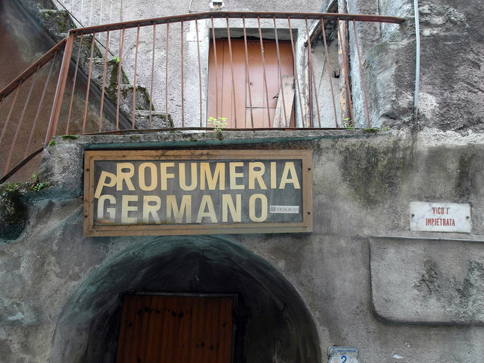 Old shop signboard Italia Old Town South Italy Arch Architecture Balcony Building Exterior Built Structure Close-up Communication Door Entrance No People Old Shop Outdoors Shop Signboard Text Verbicaro Window