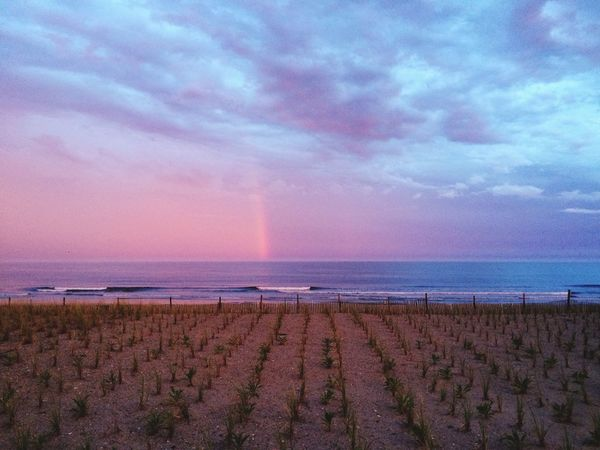 Rainbow over the ocean Rainbow After The Storm Rockawaybeach Thunderstorm Waves Sand Sunset Ocean Surf Beach Shoreline