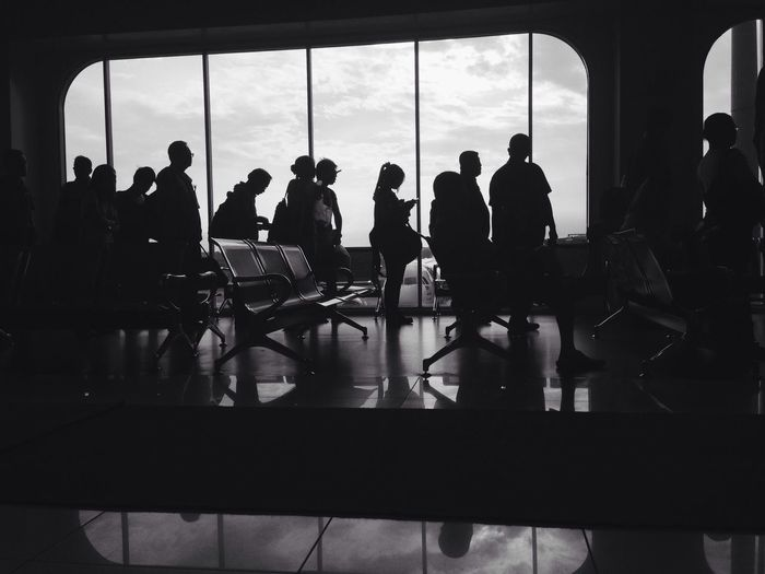 Silhouette People At Airport Terminal