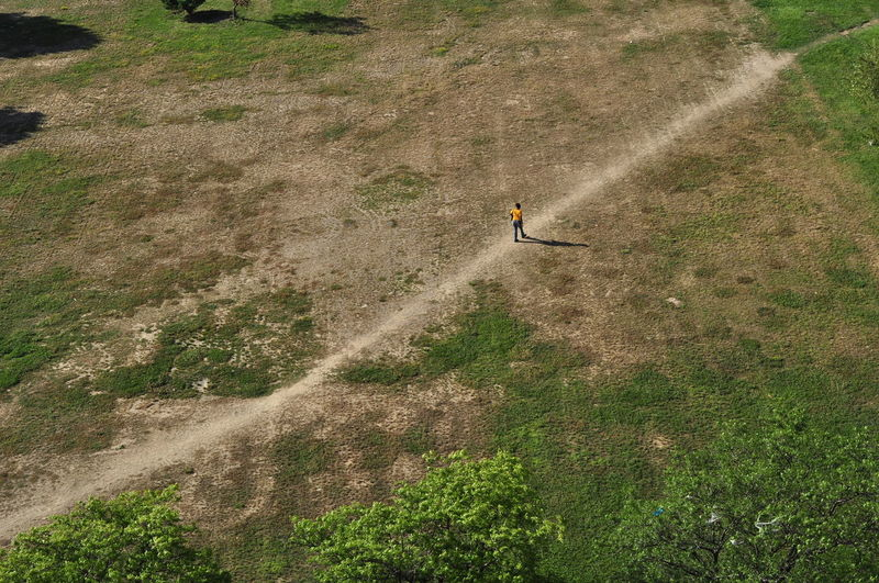 High angle view of man walking on field