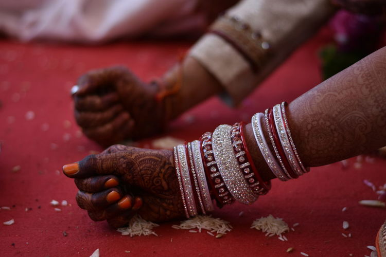 Cropped image of bride and broom hands during wedding
