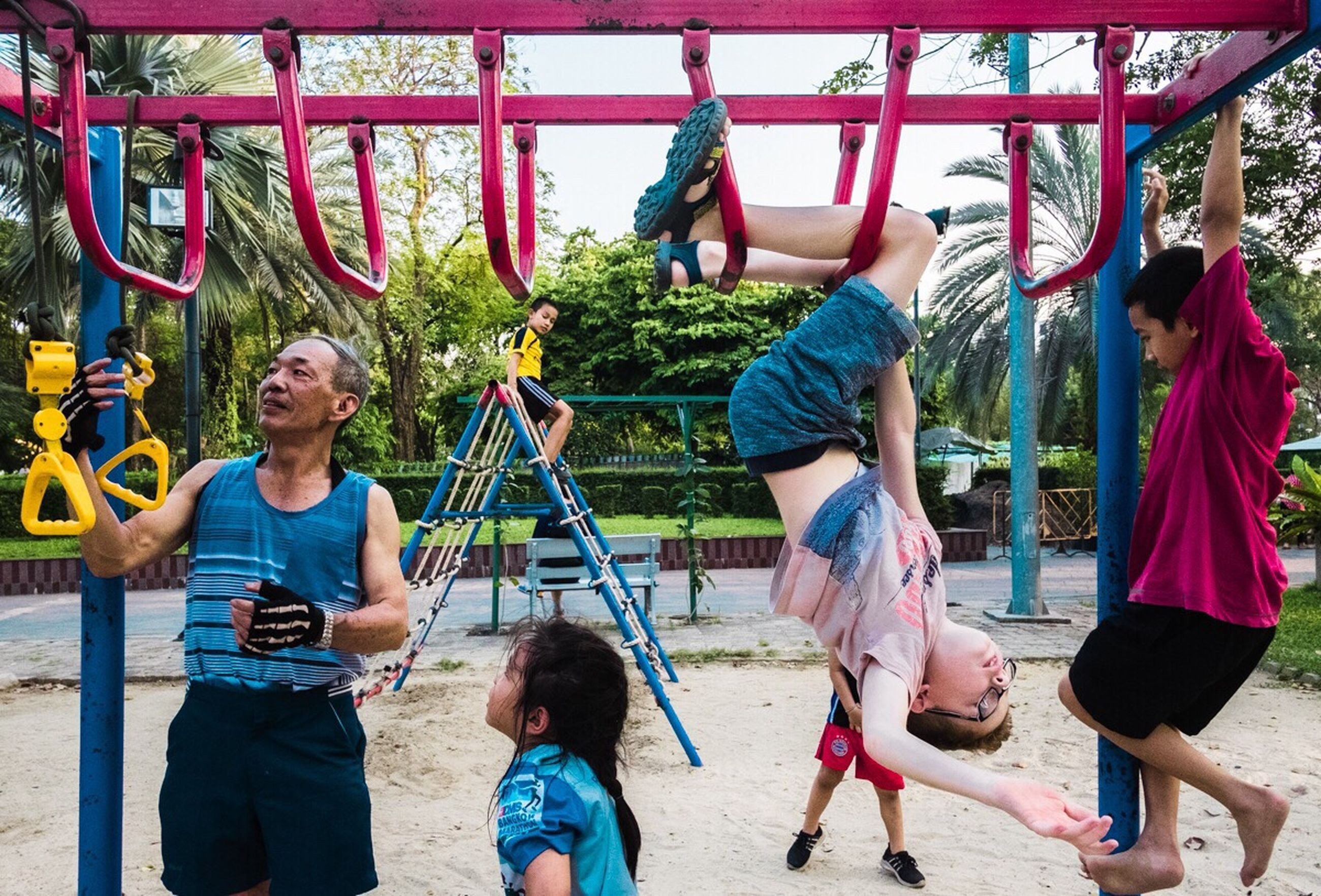 group of people, child, men, real people, lifestyles, girls, childhood, males, women, day, hanging, females, boys, leisure activity, playground, people, casual clothing, playing, three quarter length, innocence, jungle gym