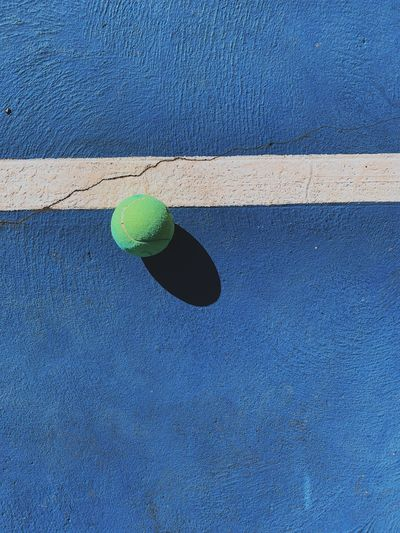 Directly above shot of ball on blue court