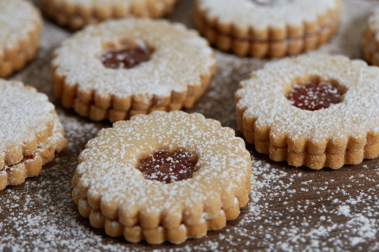 Close up of freshly baked homemade Christmas sugar cookies with jam Sweet Food Food Food And Drink Sweet Indulgence Baked Dessert Freshness Temptation Indoors  Close-up Unhealthy Eating No People Cookie Still Life Large Group Of Objects Selective Focus Ready-to-eat Homemade Cake Baked Pastry Item Snack Cooling Rack Homemade Freshness Jam Freshly Baked Freshly Cookies
