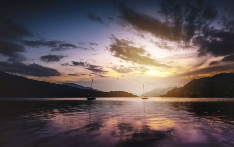 Sommergefühle at Milstätersee in Austria Sunset Water Mountain Lake Reflection Landscape Scenics Nature Outdoors Tranquil Scene Cloud - Sky Beauty In Nature Nautical Vessel Sky Day No People