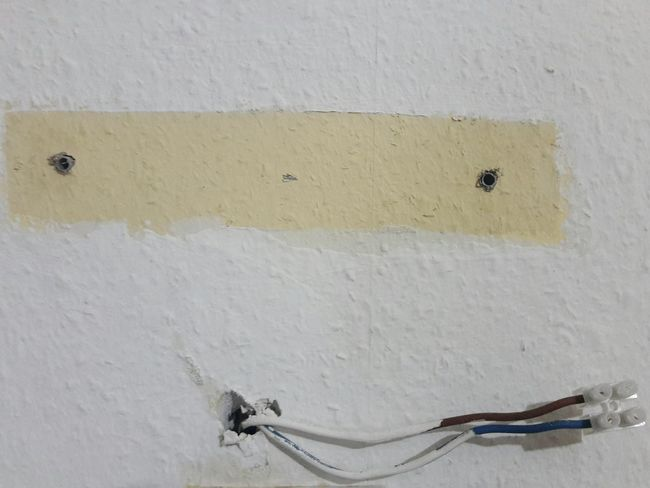 """Sunday series: Faces """"Electrify me."""" ... No People Textured  Close-up Old Part Of Indoors  Day Wall Wall Paper Paint Electricity  Electric Switch Holes Eye Eyes Eyes Everywhere Iseefaces Face Faces Of EyeEm Faces In Places Facesinthings Faces White Cheeky"""