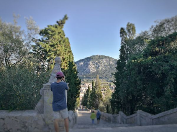 Holiday Mallorca SPAIN Travel Travel Photography Clear Sky Day Human Representation Leisure Activity Lifestyles Looking At Camera Nature One Person Outdoors People Photographer Pollença Real People Sky Stairways Standing Tree Young Adult Young Men