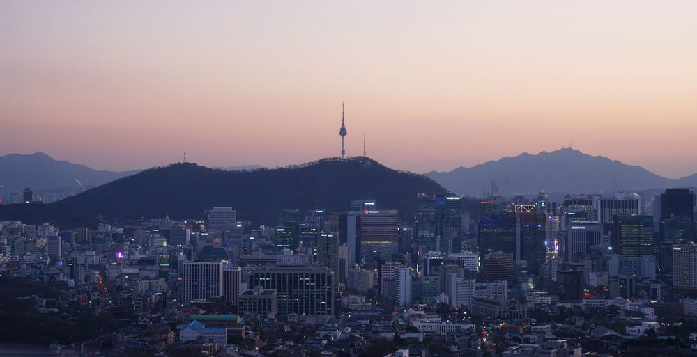 Bukak Mountain Namsan Tower  Twilight Architecture Beauty In Nature Building Exterior Built Structure City Cityscape Crowded Day Landmark Modern Mountain Nature Outdoors Seoul City Sky Skyscraper Sunset Travel Destinations