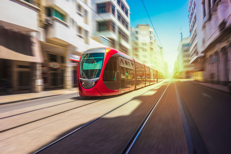 Casablanca, Morocco Tram Architecture Blurred Motion Building Exterior Built Structure City Day Land Vehicle Mode Of Transportation Motion Nature No People on the move Outdoors Public Transportation Rail Transportation Railroad Track Speed Sunlight Track Train Train - Vehicle Tramway Transportation