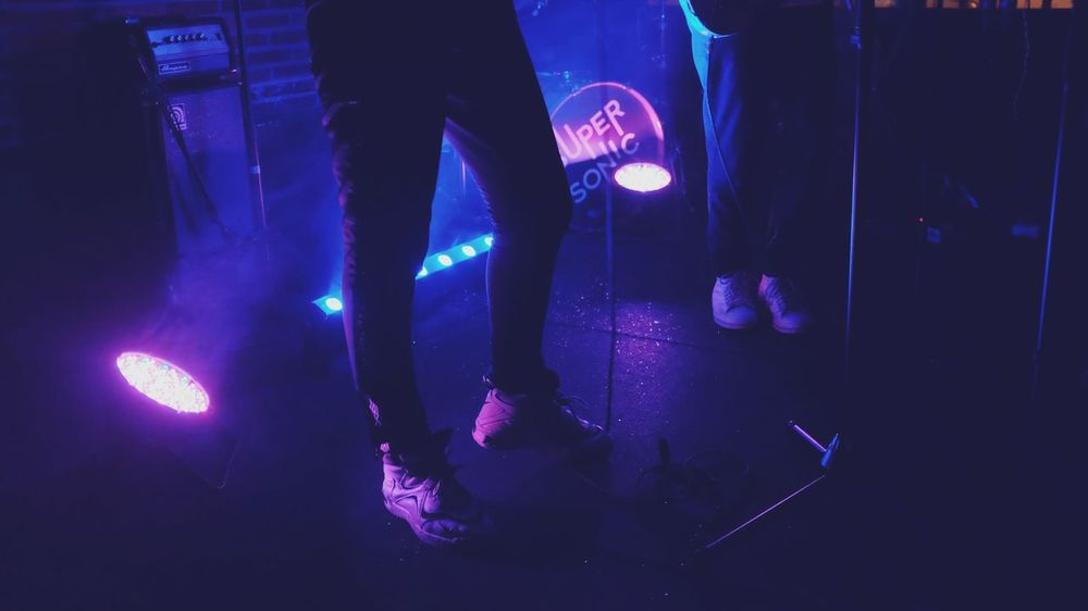 Aesthetics Gig Light Lights Performer  Arts Culture And Entertainment Club Feet Human Leg Indoors  Legs Lifestyles Light And Shadow Musician Night Nightclub Nightlife Performance Sneakers Spotlight Stage - Performance Space Violet Color EyeEmNewHere