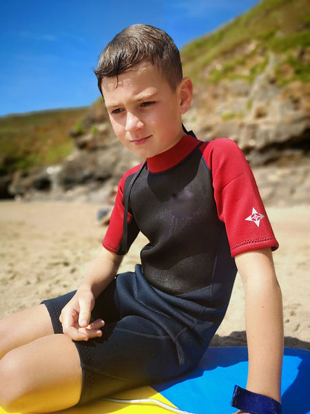 quitey reflecting after a bit of bodyboarding Eye Em Portraits Bokeh Cornish Life Boy In A Wetsuit Water Child Childhood Sitting Boys Males  Beach Summer Portrait Activity Sand