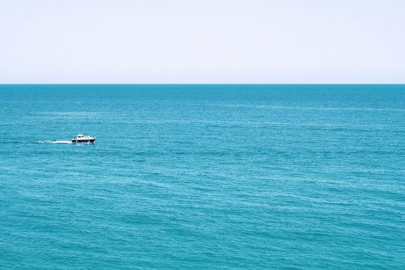 Minimalistic Landscape_Collection Minimalism Ship Water Sea Scenics - Nature Beauty In Nature Horizon Over Water Day Horizon Transportation Mode Of Transportation Tranquil Scene Nautical Vessel Waterfront Tranquility Sky Blue Idyllic Outdoors Rippled Copy Space Nature