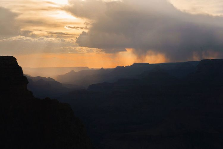 Grand Canyon Cloud - Sky Beauty In Nature Sky Scenics - Nature Mountain Sunset Environment Nature No People Tranquility Tranquil Scene Silhouette Landscape Non-urban Scene Idyllic Land Mountain Range Outdoors Orange Color Power In Nature My Best Travel Photo