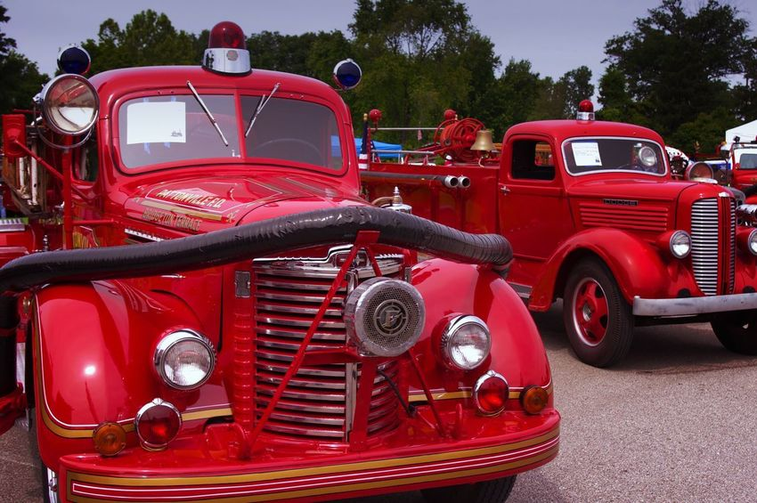 Antique fire trucks at classic car show Red Fire Engine Transportation Day Land Vehicle Stationary Close-up Display Red Firefighter Outdoors Exposition Rare Fire Department History Historic Dodge International Harvester