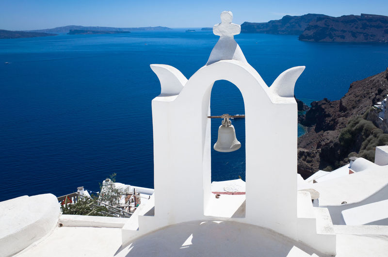 Bell Tower - Tower Cross Shape Cultures Day Greece No People Outdoors Place Of Worship Religion Santorini Santorini Island Santorini, Greece Sea Spirituality White Color Whitewashed