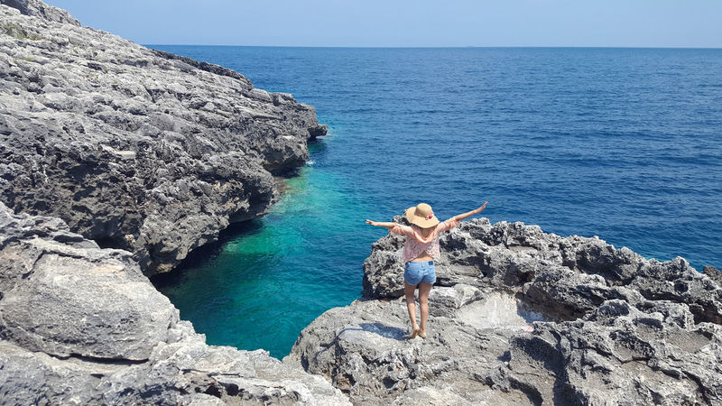 Young woman in adriatic coast, Otranto Young Women Sea Water Horizon Over Water Nature Beach Scenics Beauty In Nature Vacations Day Tranquility Outdoors Sky Clear Sky One Person Animal Themes People Mammal Adriatic Sea Salento Apúlia Otranto Italy