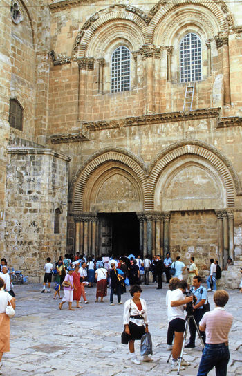 The Church of the Holy Sepulchre - Jerusalem, Israel Architecture People Real People Men Women Spirituality Travel Tourism Day History Outdoors Religion Vacations Arch Christianity Adult Adults Only Jerusalem Israel Lifestyles Place Of Worship Travel Destinations Large Group Of People Building Exterior Built Structure Ancient Religious Site The Church Of The Holy Sepulcrhre