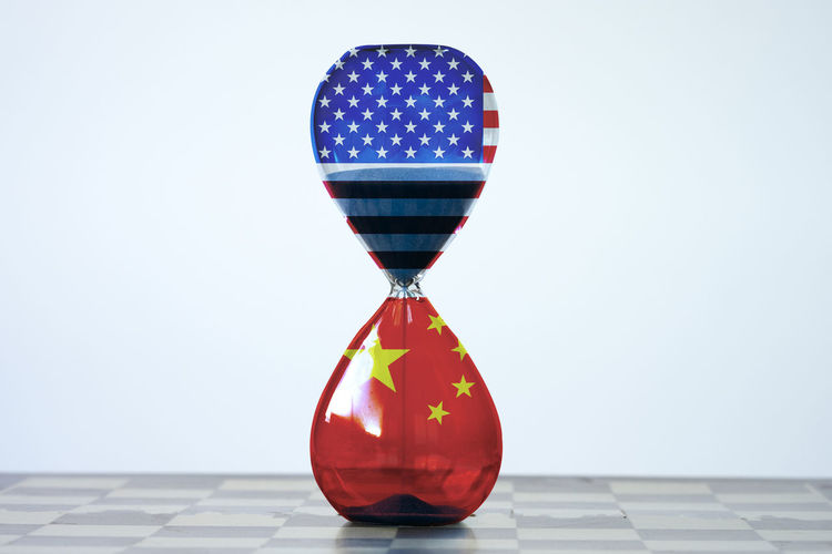 Closeup separate of USA flag and China flag on sand clock.It is symbol of tariff trade war crisis between United States of America and China which the biggest economic country in the world. America Background Banner Barrier Battle Business China Commerce Competition Conflict Crisis Defeat Design Dispute Dollar Economy Emblem  Exchange Export Fight Financial Flag Global Government Import Industry Investment Loss Money Negotiations Patriotism Policy Politics Protectionism RISK Rmb Sign Surplus Symbol Tariff Tax Trade United Us USA Versus Vs War World YUAN