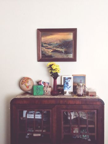 Decor. Candle Globe Kitsch Flowers Design Decor On A Budget Decorating On A Budget ApartmentLife Apartment Living Old-fashioned Picture Frame Instant Camera Transfer Image Frame Photograph Bookshelf Knowledge Paintings Literature Analog