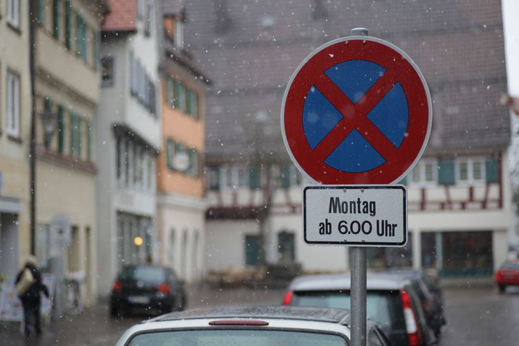 Trafficsign in south Germany Allgäu Guiding Traffic Architecture Building Exterior Built Structure Car City Close-up Day Guidance Guide Land Vehicle Mode Of Transport No People Outdoors Red Road Sign Street Traffic Sign Transportation