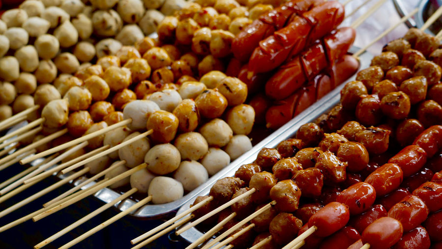 High angle view of food in skewers in market for sale