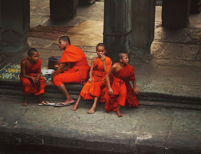Even today Angkor Wat is still a place of worship and has its Monks! Eye4photography  Monks Spirituality Travel Photography Angkor Wat Cambodia Temple Traveling People Photography People Watching Orange Peace And Quiet Showcase: February