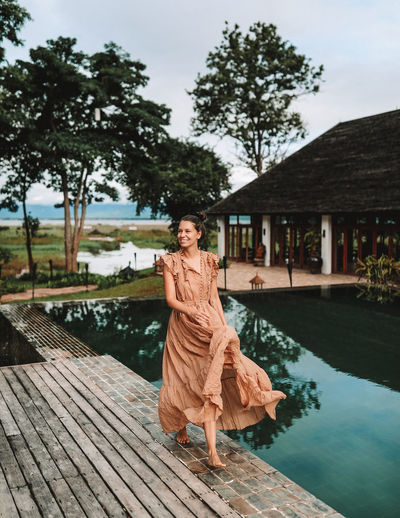 Villa Inle, Myanma / Burma Dress Woman Beautiful Woman Burma Clothing Front View Full Length Girl Inle Lake Lifestyles Long Dress Myanmar Nature One Person Portrait Real People Swimming Pool Villa Inle Walking Water Women Young Adult