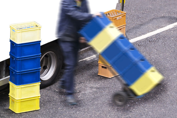 delivery worker man carries drinks box in city Delivery Delivery Service Delivery Worker Delivery Man Drinks Bottle Drink Box Container Industrial Drink Drink Glass Keg Pile Service Tank Transport Transportation Equipment Delivery Truck