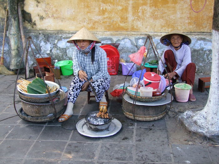 Street Restaurant & Satay Cafe Composition Container Culture Day Food Full Frame Fun High Angle View Hoi An Looking At Camera Making A Living No Incidental People Outdoor Photography Outdoors Restaurant Satay Street Traditional Traditional Clothing Vietnam