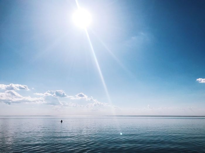 Sky Water Beauty In Nature Sunlight Sunbeam Scenics - Nature Nature Sea Blue Tranquility Horizon Over Water Tranquil Scene Sun Day Lens Flare Cloud - Sky Idyllic Horizon Non-urban Scene Outdoors