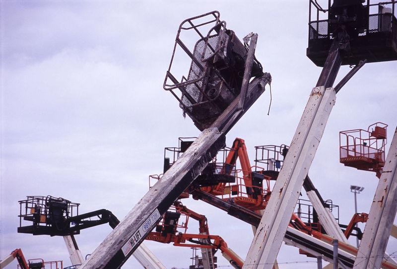 several elevated hoist platforms Access Platform Aerial Platform Builders Building Crane Development Engineering Hoist Lift Lift Platform Metal Outdoors Platform