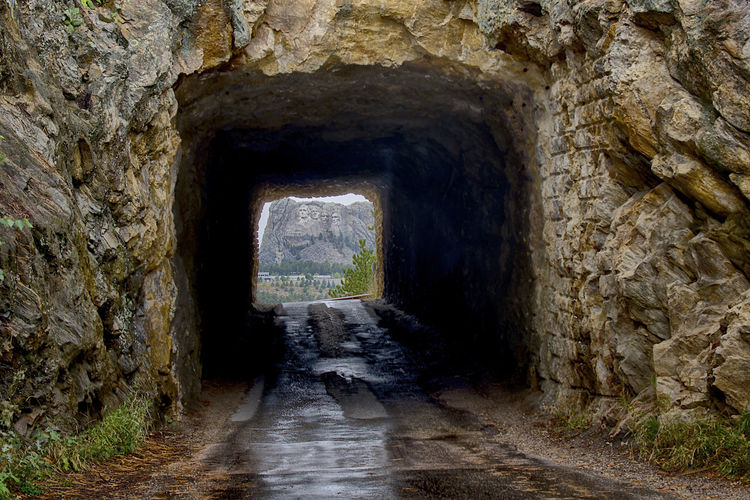 View of Mount Rushmore through a tunnel on the Iron Mountain Road. Black Hills Mount Rushmore National Memorial Scenic South Dakota Travel Travel Destinations Tunnel View