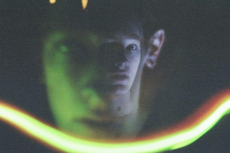 Close-up of illuminated light bulbs seen through glass