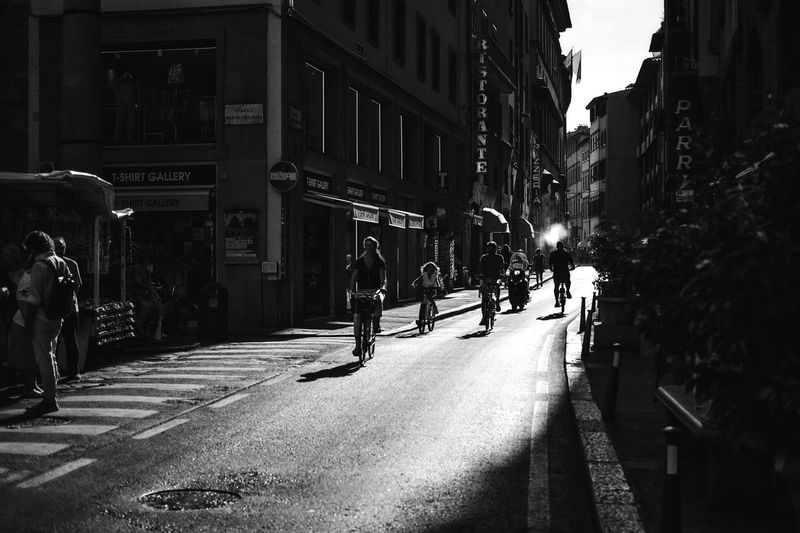 Firenze Blackandwhite Black And White Black & White Streetphoto_bw Shadows & Lights Street Photography Streetphotography Bycicle City Street Building Exterior Architecture Built Structure Transportation Group Of People City Street Road City Life Mode Of Transportation My Best Photo Streetwise Photography