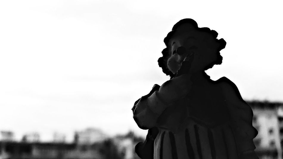 Silhouette Outdoors Sky Day Adults Only Clown Monochrome Cityscape Dark Figurine  Instrument Career People Darkness And Light Artistic Expression Arts Culture And Entertainment