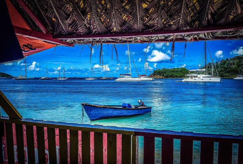 Blue Water Sky Vacations Travel Destinations Beauty In Nature Sea Caribbean Boat Sun Sunlight Ocean