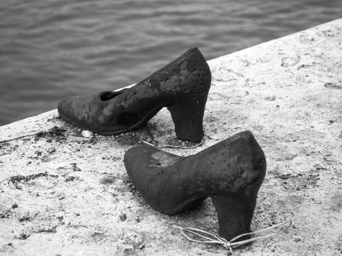 Shoes on the Danube Bank, Budapest (memorial) Budapest Budapest, Hungary Eastern Europe Memorial Mourning Shoes By The River Shoes On The Danube Bank Travel Close-up Day Focus On Foreground Hi High Heels History Killings Memorial Site No People Outdoors Sculpture Second World War Tourism Water Women's Shoes Women's Footwear