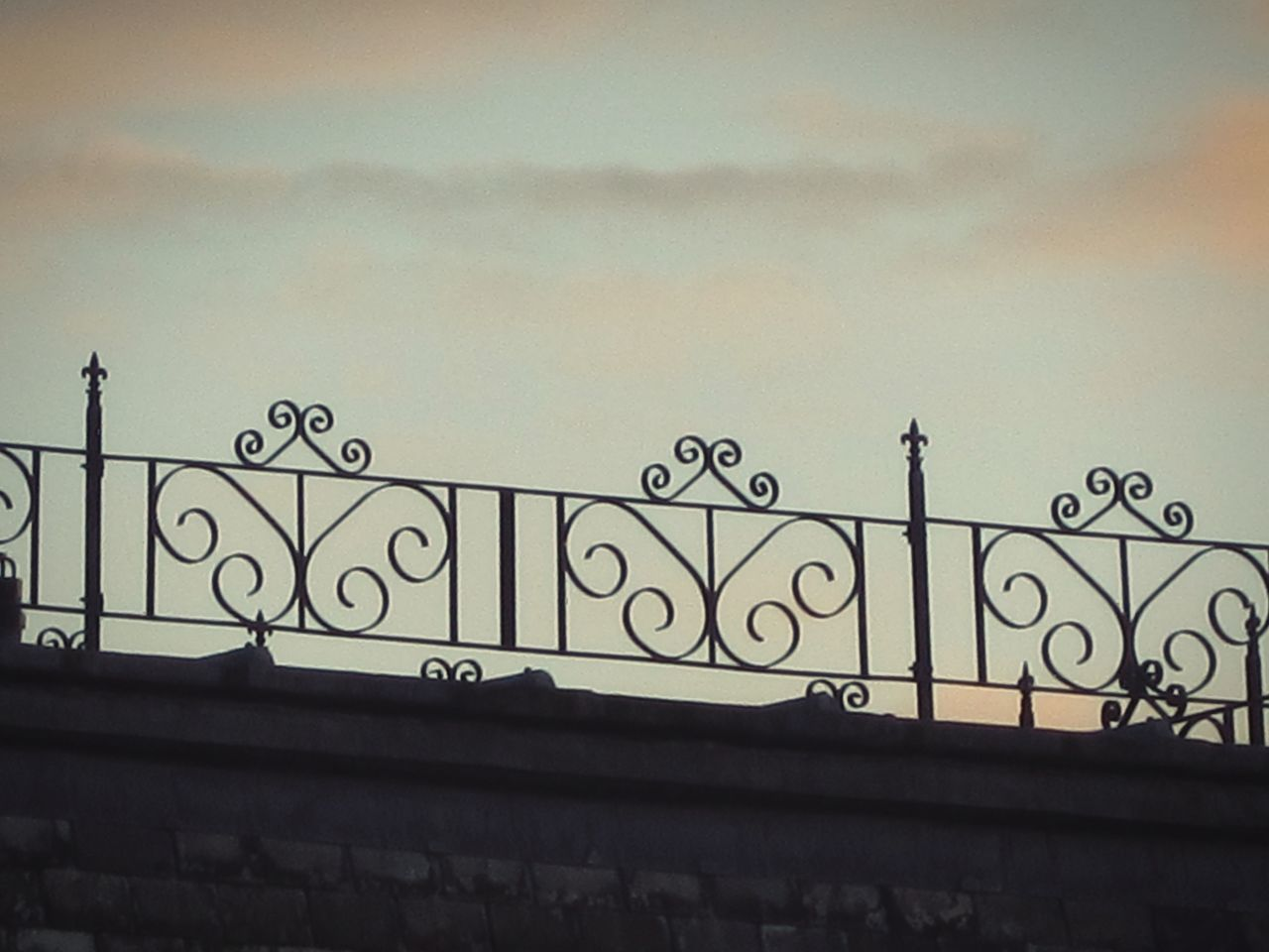 railing, architecture, built structure, building exterior, no people, wrought iron, low angle view, outdoors, sky, day, city, close-up