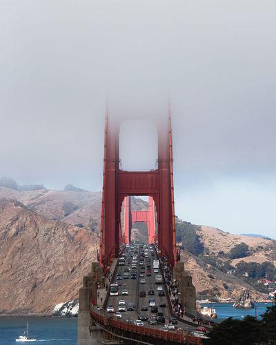 Aerial view of suspension bridge against sky