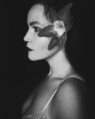 Only Women Adults Only One Woman Only One Person Portrait Beautiful Woman Human Body Part One Young Woman Only Adult Young Adult People Beauty Human Face Black Background Human Skin Headshot Beautiful People Make-up Close-up Young Women Flower Blackandwhite Black And White
