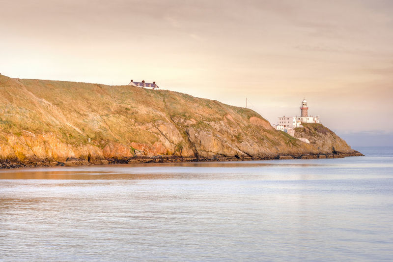 Baily lighthouse at the sunset in Howth peninsula, Dublin, Ireland Howth Irish Ireland Dublin Lighthouse Atlantic Backgrounds Bay Cliff Coast Coastline Destination Europe Mountains Nature Light Ocean Water Sea Waterfront Built Structure Architecture Scenics - Nature Beauty In Nature
